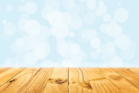 wooden plank: Abstract illustration bokeh light on blue background and wooden plank Stock Photo