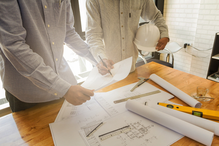 Architect discuss with engineer about project in office, architectural concept Standard-Bild