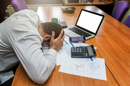 A businessman had depression and sadness in meeting room Stock Photo