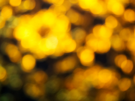 gold textured background: Abstract golden bokeh light on black background