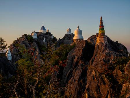Amazing pagodas on top of rock mountain at Lampang, Thailand Stock Photo