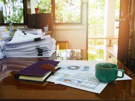 sheet of paper: A cup of coffee and office supplies in meeting room at morning