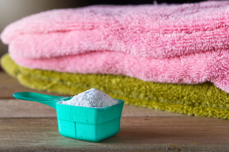 Detergent or washing powder in measuring spoon Stock Photo