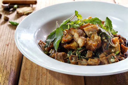 Thai food, rice topped with stir-fried streaky pork and basil Stock Photo