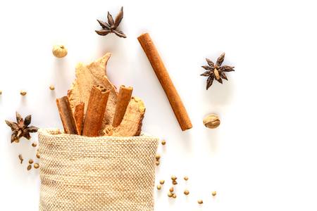 Cinnamon stick and dried ginger in sack with spices