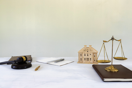 Gold brass balance scale with gavel and House model. housing and real estate law. Stock Photo