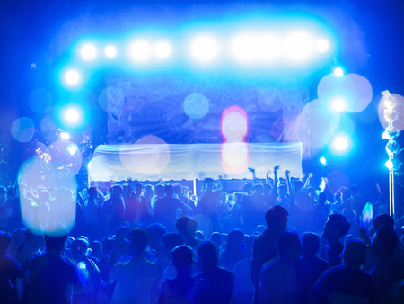 Blurred image of audience in music festival.Crowd at concert. blurred movement. Motion blur Stock Photo