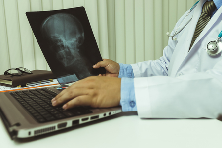 Doctor diagnose and analyze on x-ray film of patient. Stock Photo