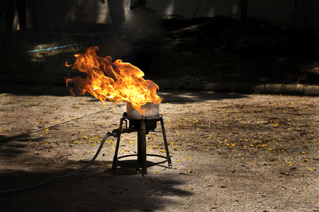 Flames caused by the explosion of the oil. Demonstration of water on oil fire. Stock Photo