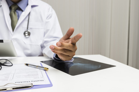 A doctor consults patient while sitting at the table in office. Medicine and health care concept. Standard-Bild - 112676875