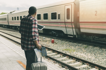 Traveler with baggage and map in train station. Travel concept. Standard-Bild - 112676902