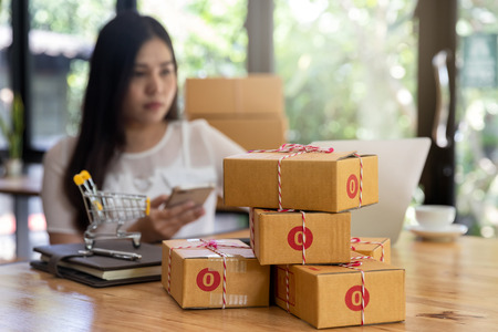 Cardboard parcel box at workplace of startup small business owner for online selling. Standard-Bild - 112676905