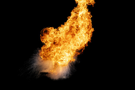 Flames caused by the explosion of the oil. Demonstration of water on oil fire. Standard-Bild - 116539916