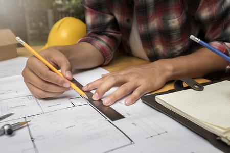 Architect measuring scale on blueprint in construction site Standard-Bild - 116540562