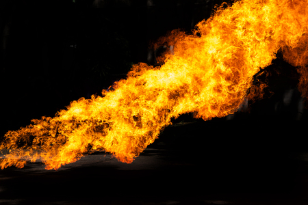 Flames caused by the explosion of the oil isolated on black background. Demonstration of water on oil fire. Stock Photo
