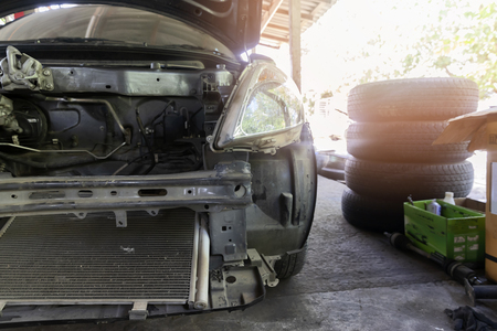 Car without engines waiting to be repaired in the car repair garage. Banco de Imagens