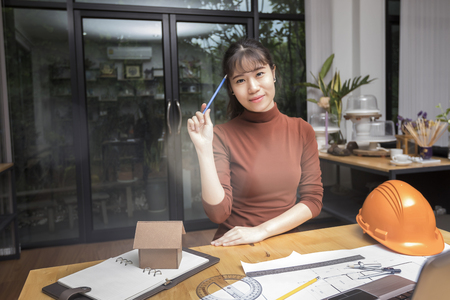 Female architect working with new startup project at home office. Standard-Bild - 116540700