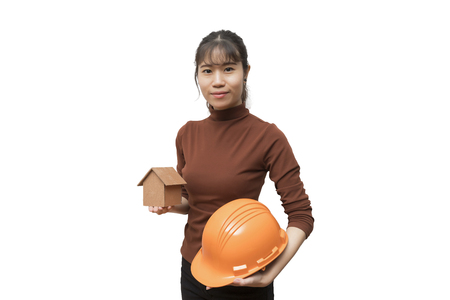 Female architect with house model and helmet isolated on white background. Standard-Bild - 116540703