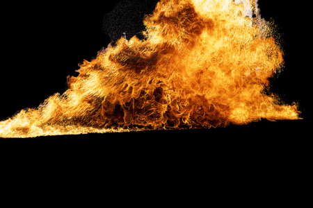 Flames caused by the explosion of the oil. Demonstration of water on oil fire. Standard-Bild - 116524702