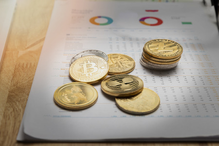 Stack of Various golden and silver of Cryptocurrency on chart or graph paper. New Virtual money concept. Standard-Bild - 121848309