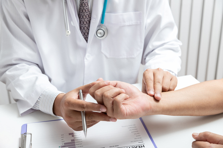 Doctor examining patient pulse by hands. Healthcare and medical service. Standard-Bild - 121848312
