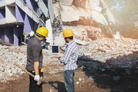 Demolition control supervisor and contractor discussing on demolish building. Standard-Bild - 123831250