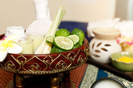 Kaffir lime or bergamot, lemongrass and other thai herbs in thai spa and massage shop. Banco de Imagens