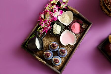Top view of Skin care products. Sea salt, essential oil and treatment body scrubs in basket.
