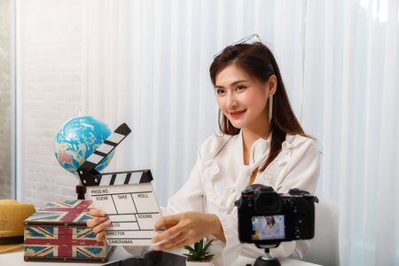 Young asian woman traveler blogger selfie herself with smart phone while recording vlog video live streaming. blogger and vlogger online influencer on social media concept.; 写真素材