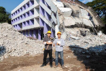 Demolition control supervisor and contractor on demolish building.