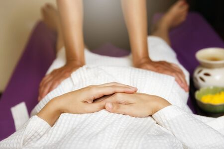 Woman receiving massage service from masseuse in spa salon thai spa and massage shop.