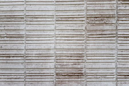 Abstract weathered texture stained old stucco light gray and aged paint white brick wall background. Brick wall may used as background.