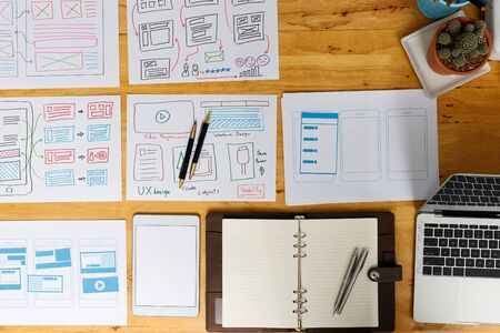 Top view of Creative flat lay UX designer working space and office supplies. Smartphone application layout prototype project. Stock Photo - 134871139