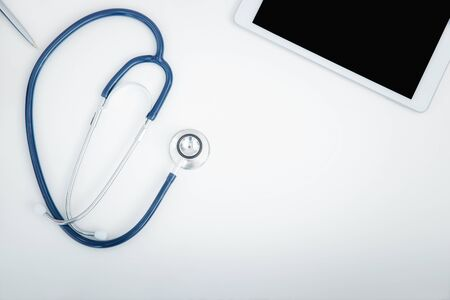 Top view of stethoscope and digital tablet computer. Technology and medical concept.