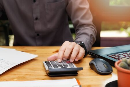 Financial businessman accounting calculating cost economic budget in home office. Investment and saving concept.