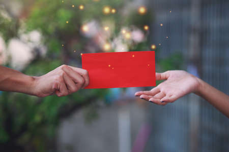 The elders hand give red envelope