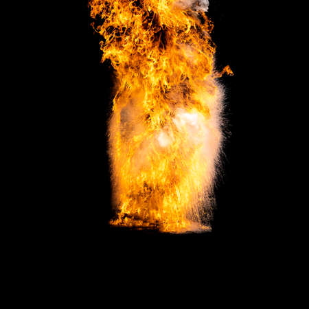 Flames caused by the explosion of the oil isolated on black background. Demonstration of water on oil fire. Stock fotó