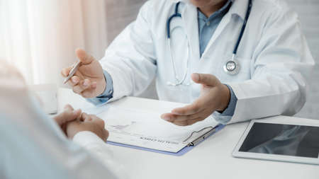 A doctor consulting and explain patient health check in office. Medicine and health care concept.