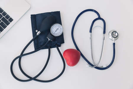 Top view of stethoscope with Sphygmomanometer; Aneroid manual blood pressure gauge and laptop. Technology and medical concept.