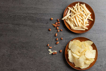 Top view of potato chips, french fries snack in dish and peanut. Stock fotó