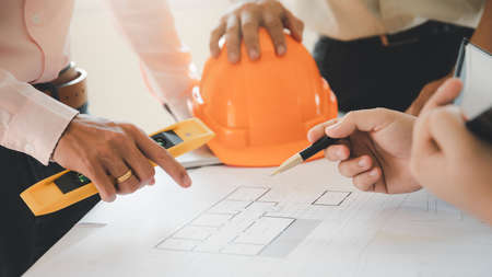 Confident team of architect working together in a office.Then discussing about new startup project on desk. Architect discuss with engineer about project in office, architectural concept.