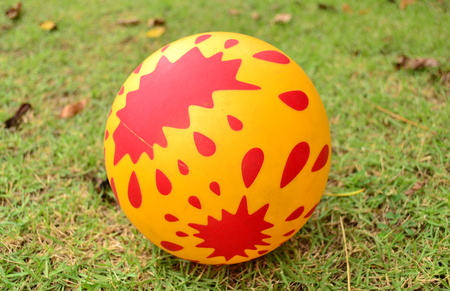 rubber ball: The rubber ball, it rolling on the grass. Stock Photo
