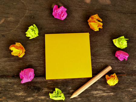 note board: Post it note and pencil on wooden board Stock Photo