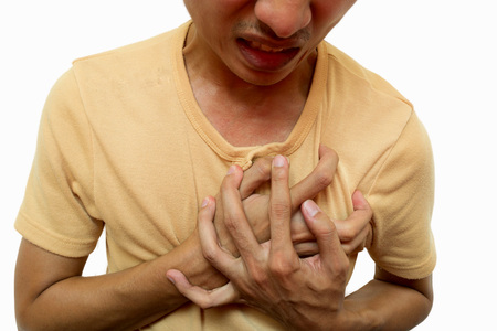 heartattack: Young man has chest pain from heart attack isolated, it has clipping path