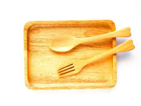 dish disk: Wooden plate and spoon on white backgound