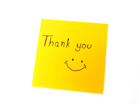 someone: Writting Thank you on post note for someone