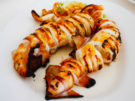 Sour and spicy steam squids grilled in thai foodwith selective focus 免版税图像