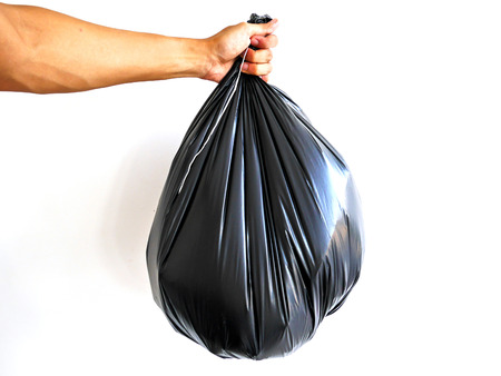 Right hand hold big garbage bag isolated on white background