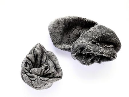 Used grey socks isolated on white background