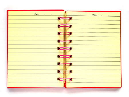 Old pink note book isolated on white background 免版税图像